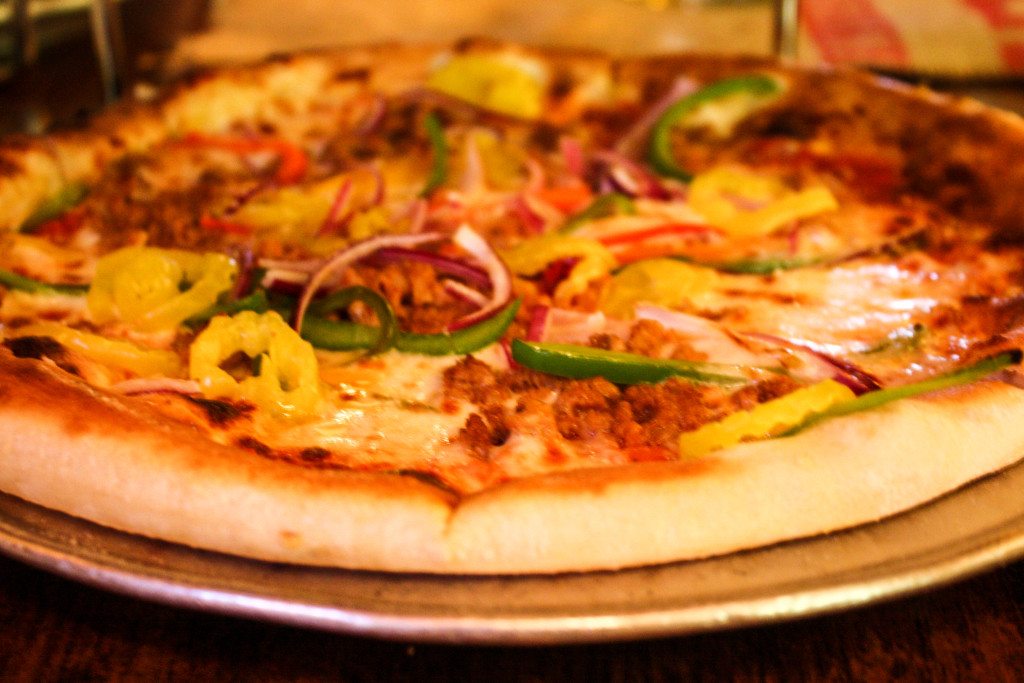 Pizza topped with peppers and Italian sausage at Ottava Via (Erin Klema/The Epicurean Traveler)