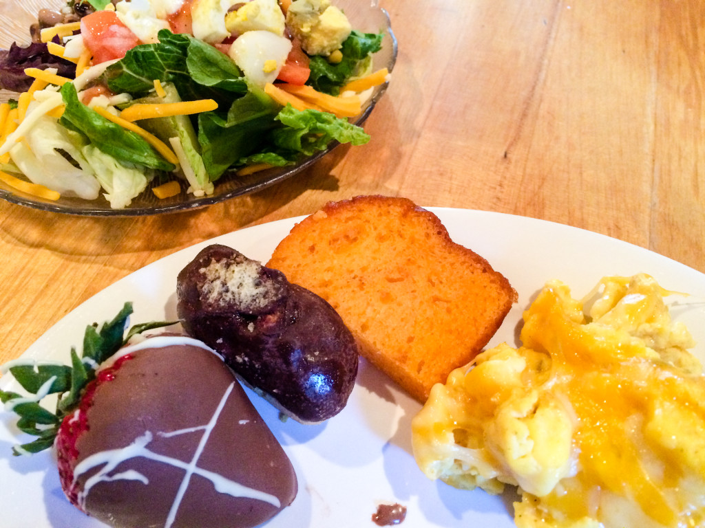 My final round of this Hofbrau Sunday brunch included a salad, scrambled eggs topped with cheese, sweet orange bread, mini eclair and a chocolate-covered strawberry. Yum! (Photo by Erin Klema)