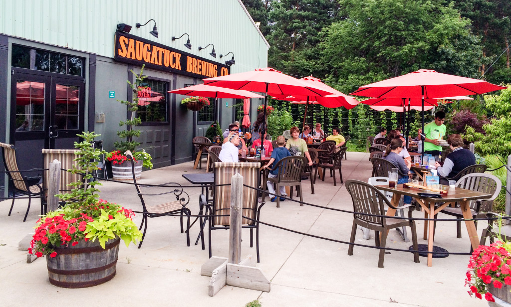 Diners drink craft beer on the patio of Saugatuck Brewing Co. in Saugatuck, Michigan.