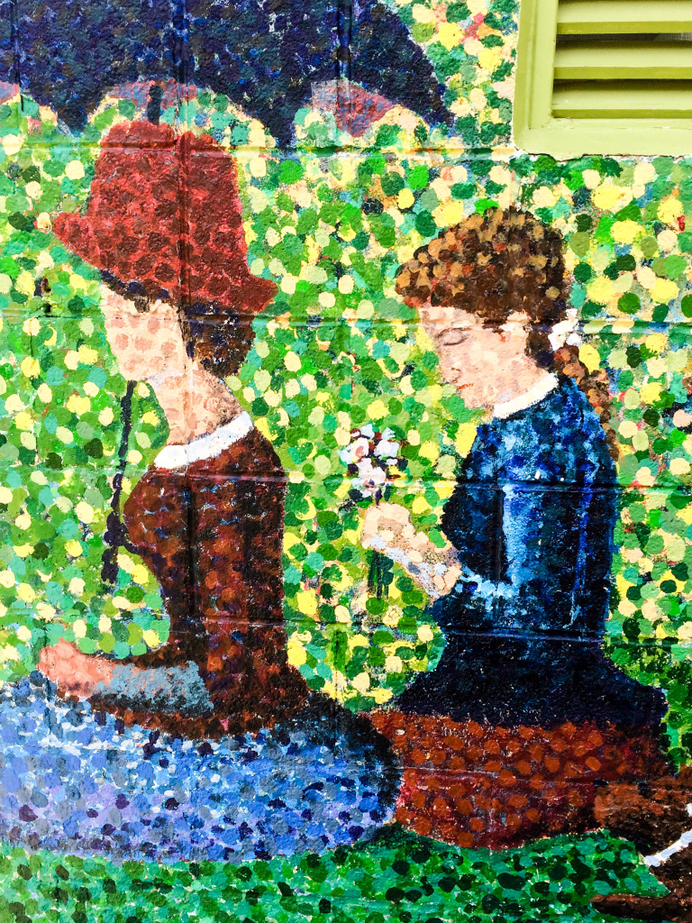Pointillism mural of two women in Saugatuck, Michigan