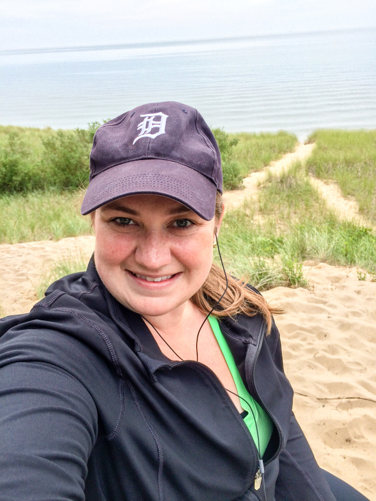 A young Michigan woman takes a selfie at Saugatuck Dunes State Park in Saugatuck, Michigan.