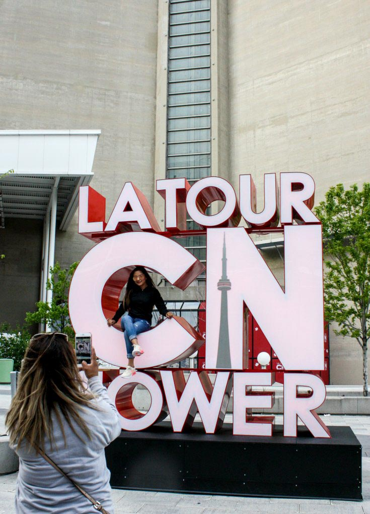 Taking touristy photos at the CN Tower is a must when visiting Toronto, Canada!