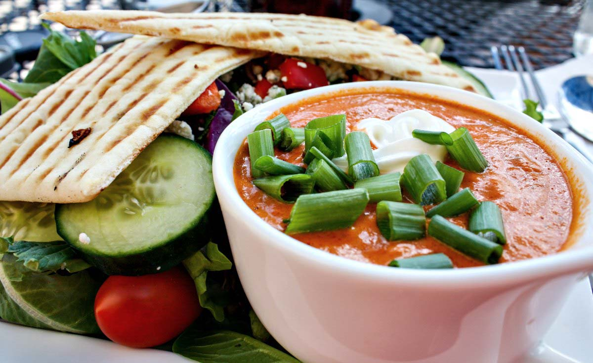 Roasted red pepper soup with rainbow salad and pita bread at Wild Goose Meeting House in Colorado Springs, Colorado