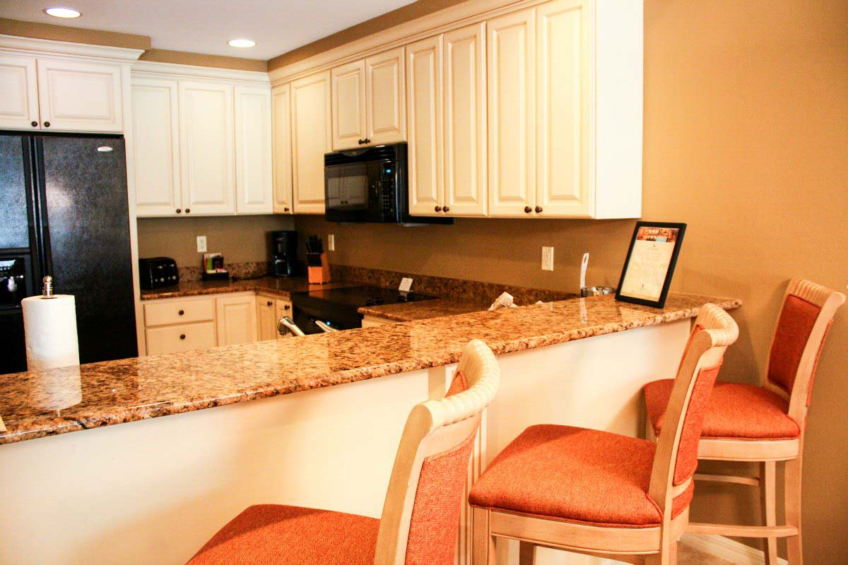 Looking into the full kitchen of the Bellasera Resort's two-bedroom suite in Naples, Florida