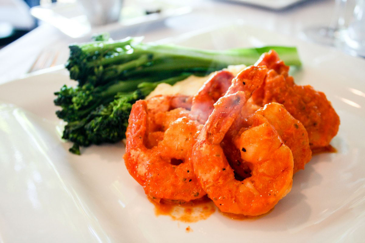 Shrimp, polenta, and broccolini at Twisted Olive, a coastal Mediterranean restaurant in Petoskey, Michigan