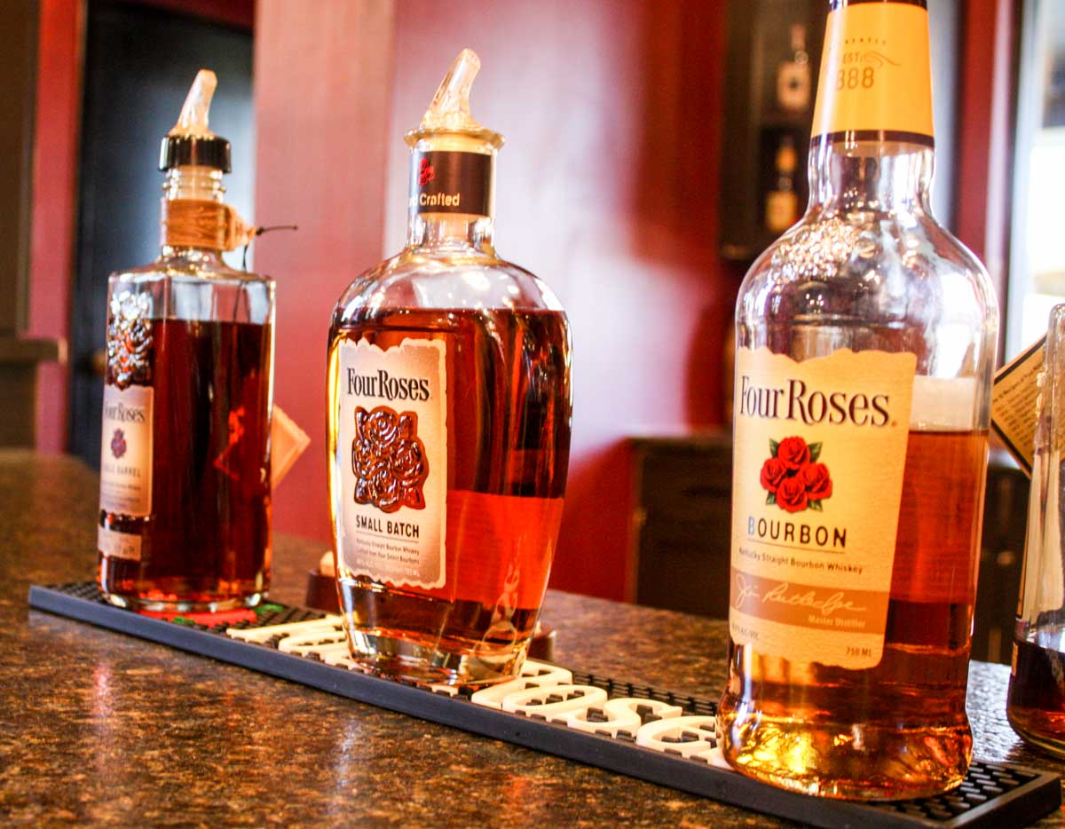 Three Four Roses bourbon bottles lined up for a bourbon tasting