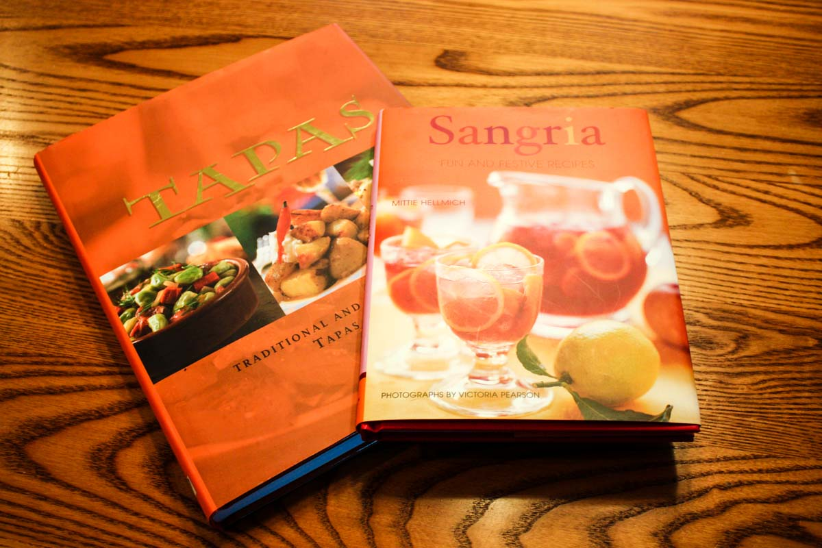 Tapas and Sangria cookbooks on wooden dining table