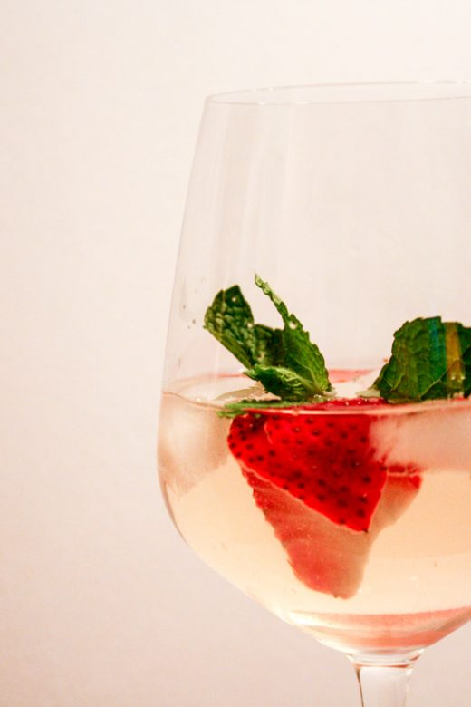 Strawberry Mint White Sangria in wine glass