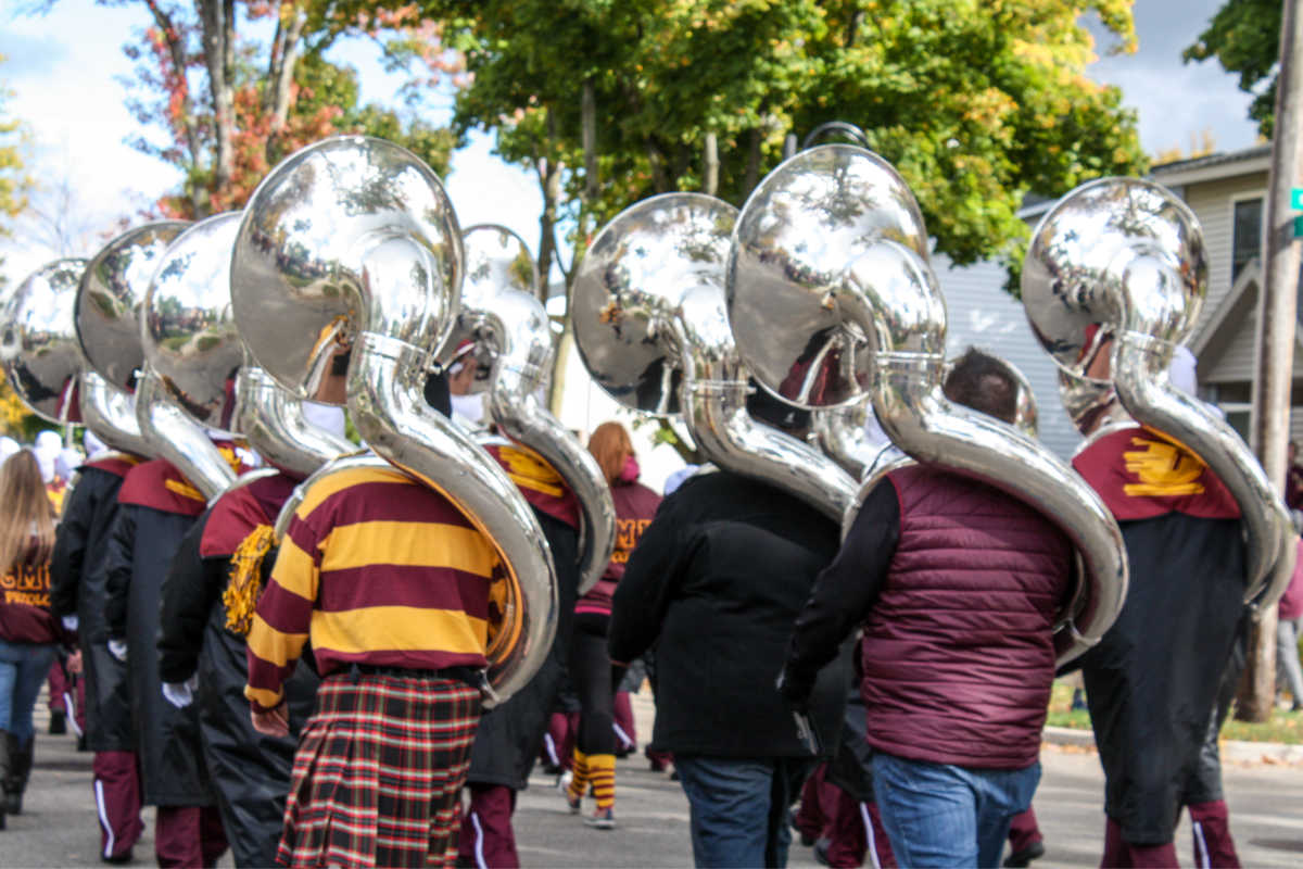 Central Michigan University Marching Chips walk in Homecoming parade