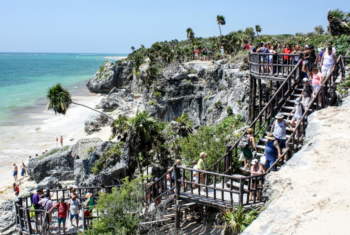 Tulum, Mexico cliffside staircase to the beach and Caribbean Sea. | EpicureanTravelerBlog.com