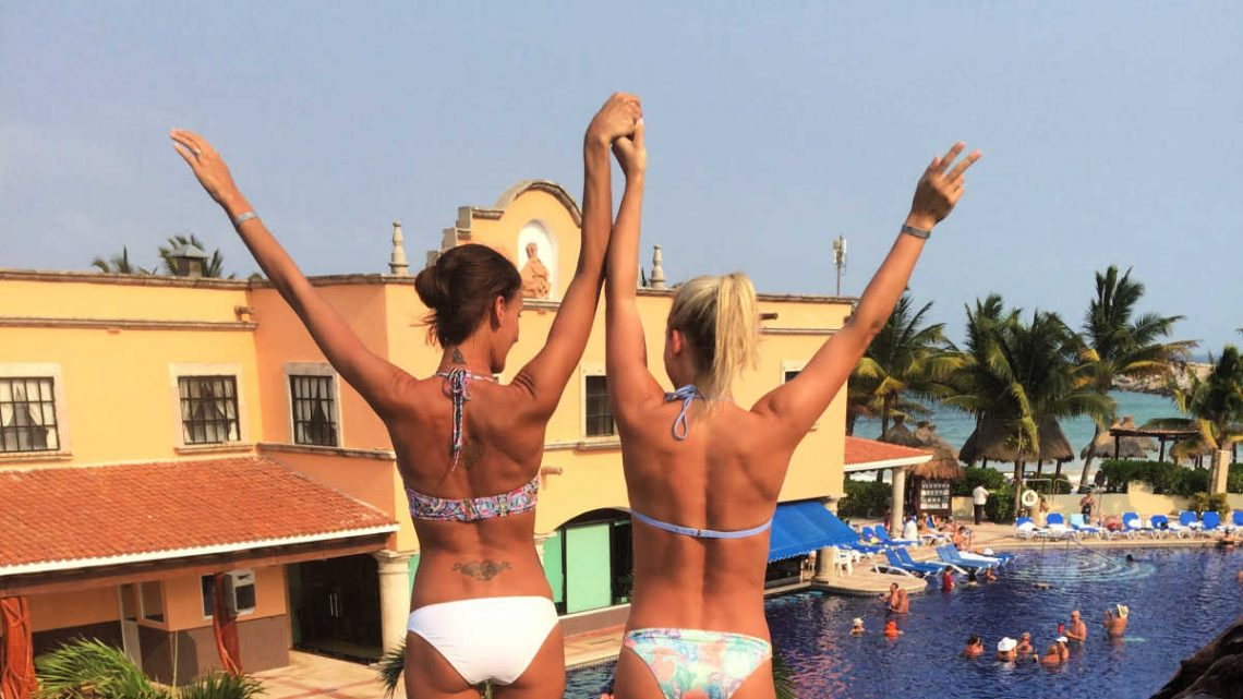 Friends get ready to jump into the pool at Hotel Marina El Cid in Mexico's Riviera Maya