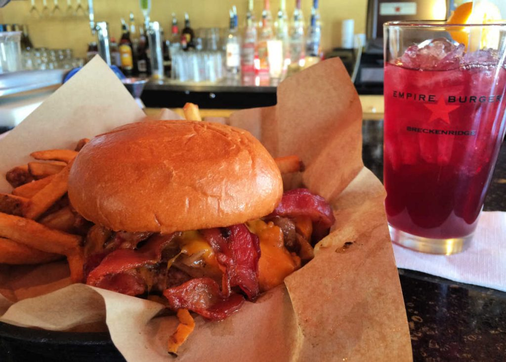 Western Burger with fries and sangria at Empire Burger in Breckenridge, Colorado, USA
