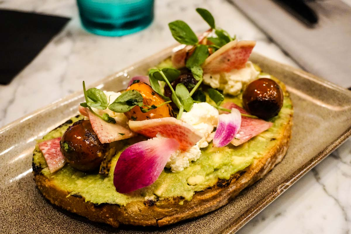 Avocado toast at Local Motives, the flagship restaurant of the W Atlanta Downtown