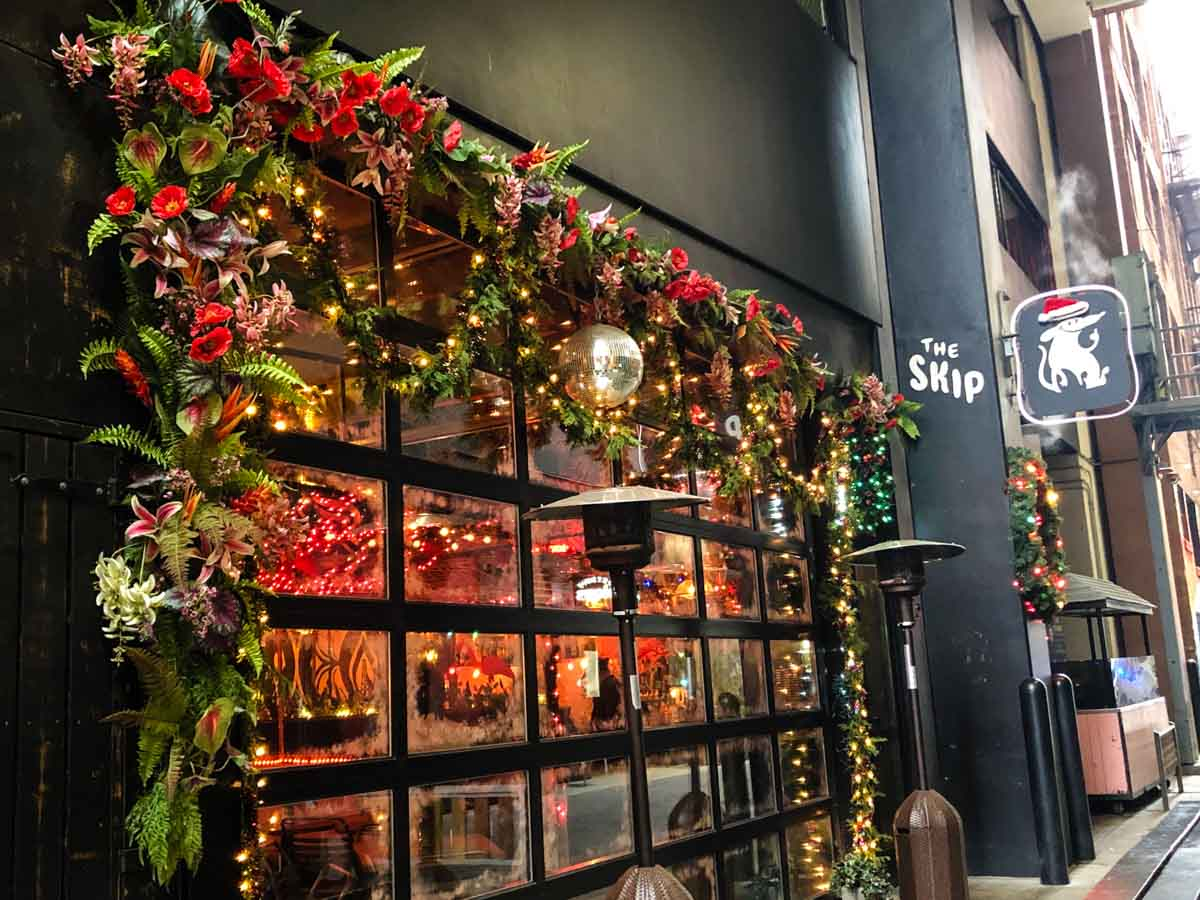 Decorated for the holidays, downtown Detroit bar hosts pop-up Sippin' Santa at The Skip.