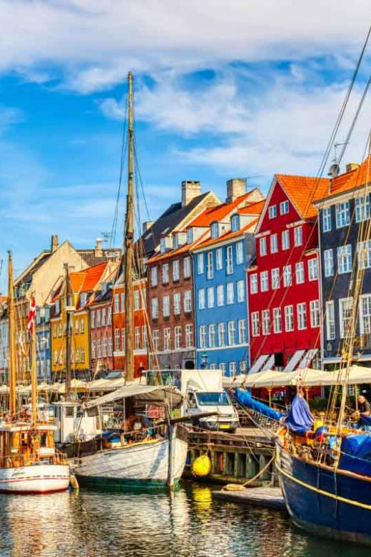 Copenhagen Nyhavn port with colorful buildings and sailboats