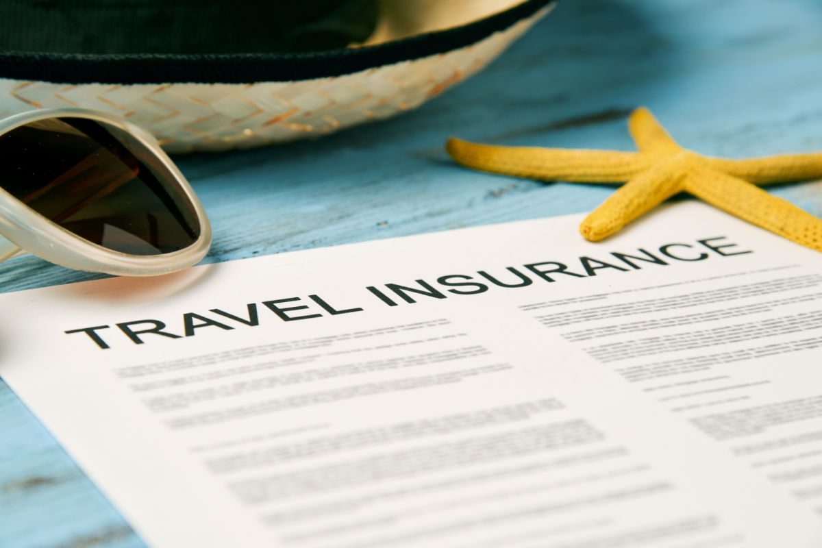 Travel Insurance Policy with straw hat, sunglasses, and starfish
